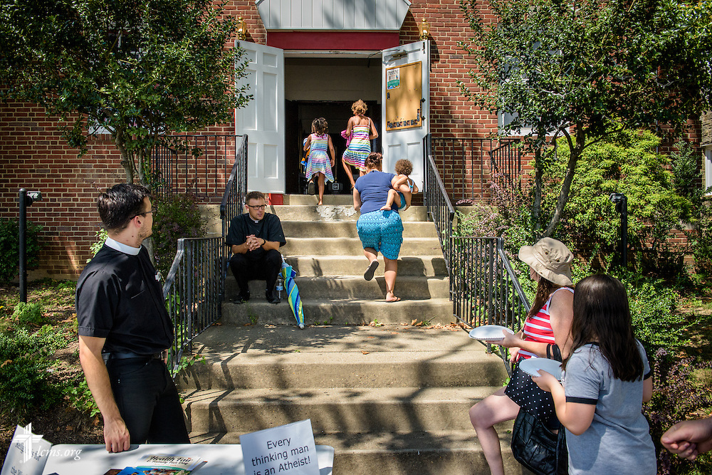 Visitors arrive for the first domestic Mercy Medical Team on Friday, Aug. 26, 2016, at Shepherd of the City Lutheran Church in Philadelphia. Vicar Jacob Benson (left) and the Rev. Adam DeGroot, missionary pastor at the church, wait on the steps. LCMS Communications/Erik M. Lunsford