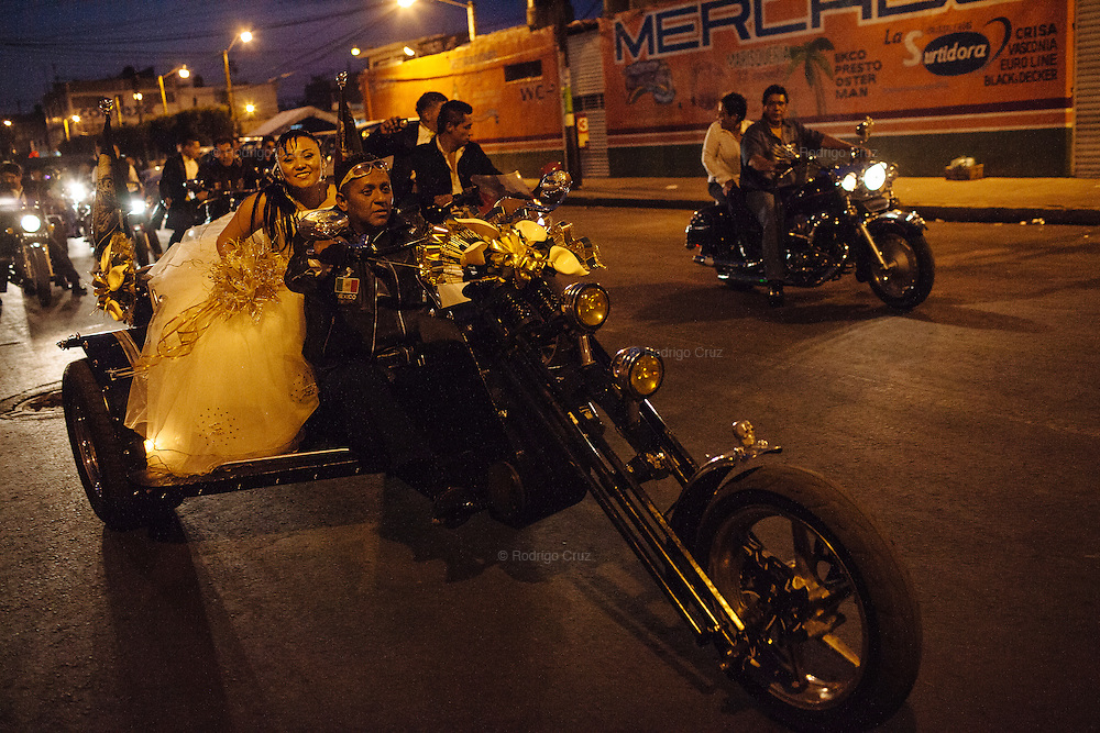 A young woman travels by motorcycle at night as part of her fifteenth birthday celebration in Ciudad Nezahualcoyotl, April 2, 2011.