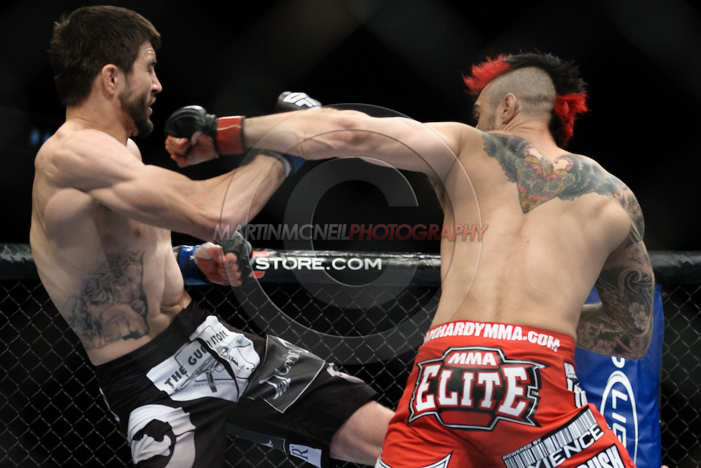 """LONDON, ENGLAND, OCTOBER 2010: Carlos Condit (left) is clipped by a punch from Dan Hardy during """"UFC 120: Bisping vs. Akiyama"""" inside the O2 Arena in Greenwich, London"""