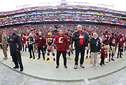 Nov 18, 2018; Landover, MD, USA; Washington Redskins head coach Jay Gruden stands with his team during the national anthem before playing against the Houston Texans at FedEx Field. The Texans beat the Redskins 23-21. (Steve Jacobson/Image of Sport)