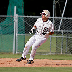 07 May 2009: High school playoff baseball playoff game between the Manny Tigers and the St. Thomas Aquinas Falcons played in Hammond, Louisiana.