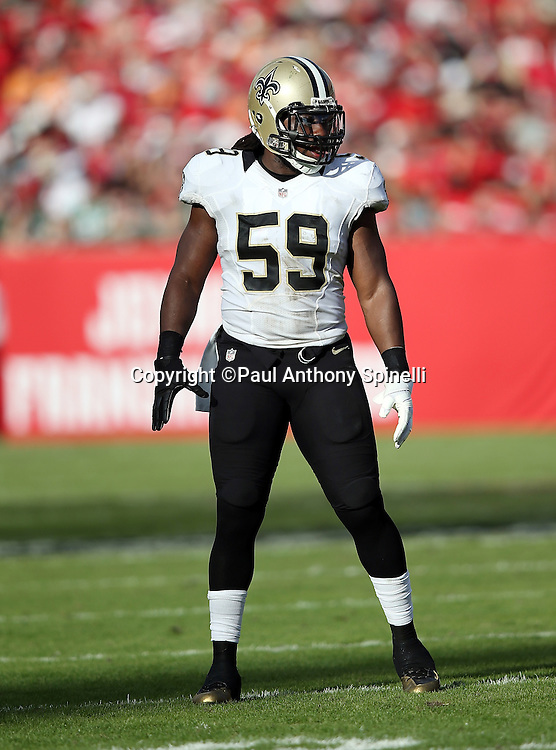 New Orleans Saints outside linebacker Dannell Ellerbe (59) looks on during the 2015 week 14 regular season NFL football game against the Tampa Bay Buccaneers on Sunday, Dec. 13, 2015 in Tampa, Fla. The Saints won the game 24-17. (©Paul Anthony Spinelli)