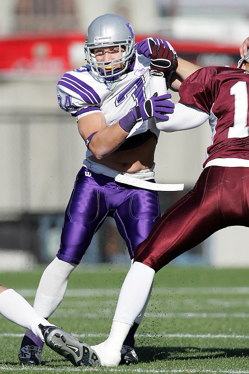 (3 November 2007 -- Ottawa) The University of Western Ontario Mustangs defeating the University of Ottawa Gee Gees lost to 16-23 in OUA football semi-final action in Ottawa. The University of Western Ontario Mustangs player pictured in action is Nick Kordic