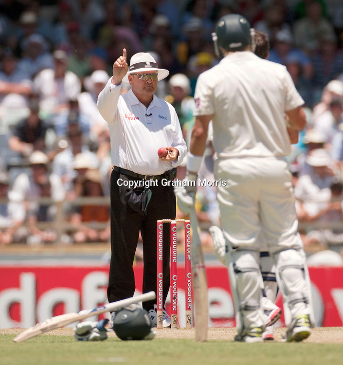 Umpire Marais Erasmus finally gives Shane Watson out, lbw for 95, after a referral during the third Ashes test match between Australia and England at the WACA (West Australian Cricket Association) ground in Perth, Australia. Photo: Graham Morris (Tel: +44(0)20 8969 4192 Email: sales@cricketpix.com) 18/12/10