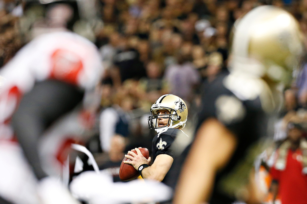 NEW ORLEANS, LA - NOVEMBER 11:  Drew Brees #9 of the New Orleans Saints looks downfield for a receiver against the Atlanta Falcons at Mercedes-Benz Superdome on November 11, 2012 in New Orleans, Louisiana.  The Saints defeated the Falcons 31-27.  (Photo by Wesley Hitt/Getty Images) *** Local Caption *** Drew Brees