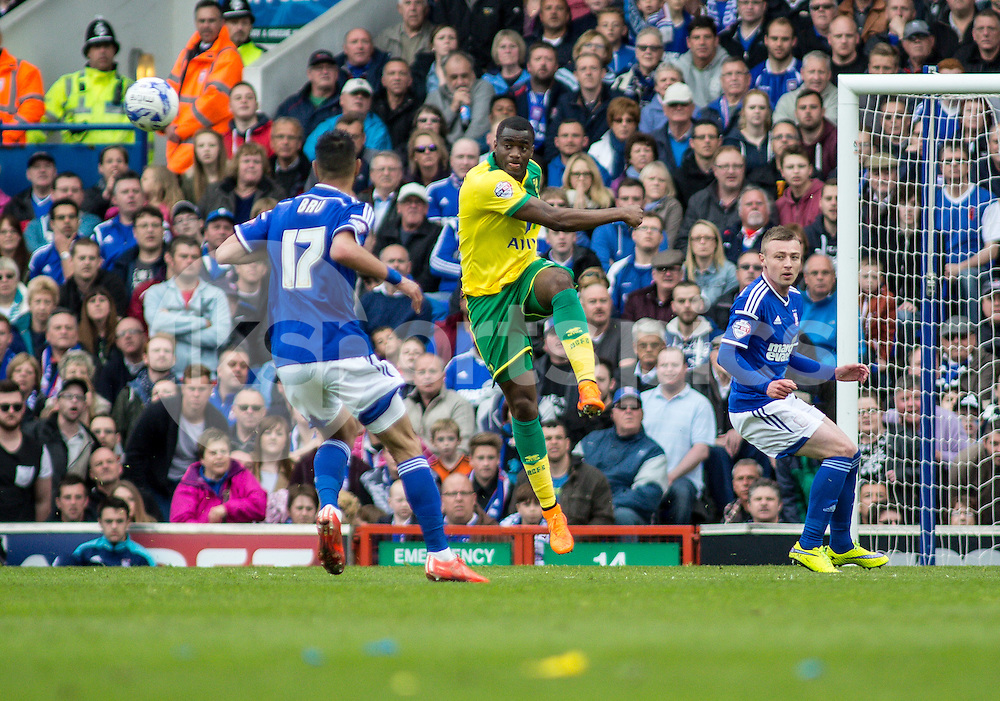 Sebastien Bassong of Norwich City clears the danger during the Sky Bet Championship Play Off 1st Leg match between Ipswich Town and Norwich City at Portman Road, Ipswich, England on 9 May 2015. Photo by Liam McAvoy.
