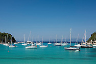 Sailing yachts moored in Lakka harbour on the island of Paxos, The Ionian Islands, The Greek Islands, Greece, Europe