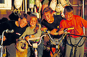 Four kids on their bikes.