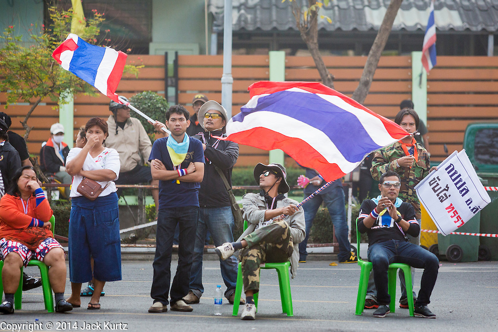 26 JANUARY 2014 - BANGKOK, THAILAND: Anti-government protestors block access to the polling places at Wat That Thong in Bangkok. Anti-government protestors forced the closure of polling places in Bangkok Sunday as a part of Shutdown Bangkok. Early voting was supposed to be Sunday January 26 but blocked polling places left hundreds of thousands of people unable to vote casting the February 2 general election into doubt and further gridlocking Thai politics. Protestors blocked access to gates and entry ways to polling places and election officials chose the close them rather than confront protestors. Shutdown Bangkok has been going for 12 days with no resolution in sight. Suthep, the leader of the anti-government protests and the People's Democratic Reform Committee (PDRC), the umbrella organization of the protests,  is still demanding the caretaker government of Prime Minister Yingluck Shinawatra resign, the PM says she won't resign and intends to go ahead with the election.    PHOTO BY JACK KURTZ
