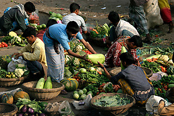 BANGLADESH DHAKA KAWRAN BAZAAR 2MARB05 -  Traders attend to their baskets with fruits and vegetables at Kawran Bazaar vegetable market. The Bazaar has been in the Tejgaon area for at least 30 years and is one of the largest markets in Dhaka city...jre/Photo by Jiri Rezac..© Jiri Rezac 2005..Contact: +44 (0) 7050 110 417.Mobile:  +44 (0) 7801 337 683.Office:  +44 (0) 20 8968 9635..Email:   jiri@jirirezac.com.Web:    www.jirirezac.com..© All images Jiri Rezac 2005- All rights reserved.