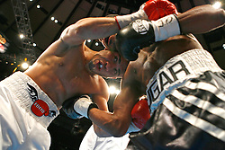 "November 10, 2007; New York, NY, USA;   WBA Welterweight Champion Miguel Cotto (white trunks) takes a body shot from ""Sugar"" Shane Mosley (black trunks) during their 12 round fight  at Madison Square Garden in New York, NY.   Cotto won the fight via unanimous decision."