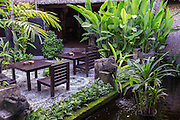 Sitting area near a fish pond at Tugu Hotel Bali.