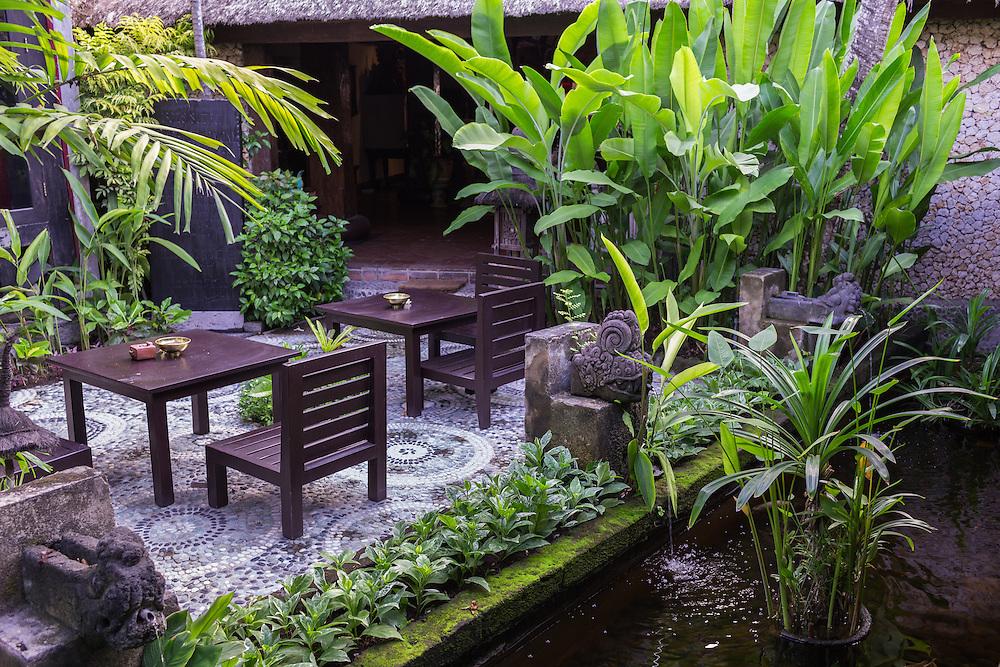 Sitting area near a fish pond at Tugu Hotel Bali.