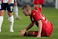GOSFORD, AUSTRALIA - OCTOBER 02: Adelaide United defender Jordan Elsey (23) sits hurt on the ground during the FFA Cup Semi-final football match between Central Coast Mariners and Adelaide United on October 02, 2019 at Central Coast Stadium in Gosford, Australia. (Photo by Speed Media/Icon Sportswire)