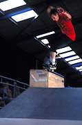 Robert Jaye nose grinding on a metal rail in a skate park, UK, 2000's