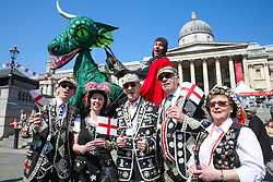 © Licensed to London News Pictures. 20/04/2019. London, UK. A man dressed as St George on a dragon along with 'Pearly Kings and Queens' attends the annual 'Feast of St George' event in Trafalgar Square, to celebrate the Patron Saint of England. St George's Day is on 23 April.  Photo credit: Dinendra Haria/LNP