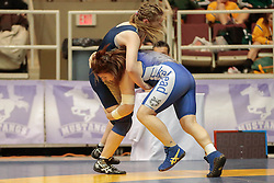 London, Ontario ---2013-03-02---  Kelsey Dayler of  Lakehead takes on  Grace Bannerman of  U Of Toronto in the women's 72 KG 5th/6th match at the 2012 CIS Wrestling Championships in London, Ontario, March 02, 2013. .GEOFF ROBINS/Mundo Sport Images