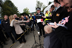 © Licensed to London News Pictures. 05/10/2012. Machynlleth Powys Wales. Surrounded by reporters photographers  and  media Police Inspector IAN JOHN giving a press conference  outside Machynlleth leisure centre,  the centre of efforts to find   five year old girl APRIL JONES abducted whilst playing outside her house on Oct 1 2012. Police are now treating this as a murder investigation and are continuing to question 46 year old local man MARK BRIDGER. Photo credit: Keith Morris/LNP