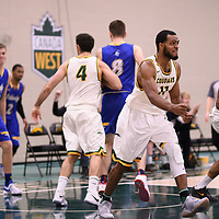 5th year forward Brian Ofori (11) of the Regina Cougars during the Men's Basketball home game on November 24 at Centre for Kinesiology, Health and Sport. Credit: Arthur Ward/Arthur Images