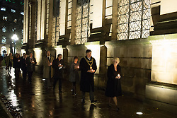 © Licensed to London News Pictures. 21/11/2016. Birmingham, UK. A service of prayer to mark the deaths of 21 people killed in the Birmingham Pub bombings on the 42nd anniversary. Pictured, Julie Hamilton followed by Lord Mayor Carl Rice about to lay a candle on behalf of her sister. credit: Dave Warren/LNP