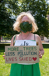 """© Licensed to London News Pictures;23/06/2020; Bristol, UK. Picture of KATIE WALLIS from the XR Bristol Arts Group wearing a mask with oak leaves that she made. Extinction Rebellion's Five a Week campaign for clean air stages a symbolic, theatrical action highlighting the number of premature deaths in Bristol due to air pollution. They have set up 5 cubes on College Green in front of City Hall with the message """"In Bristol, air pollution causes 5 deaths each week"""". People are invited to take part and bring their own placard and message around air pollution and step on top of a cube for 2 minutes in silence, then allow the next person to take their place until the """"death count"""" comes to 296. Participants are then invited to place their placards on the Green to create a sticking sea of messages. Social distancing measures are in place and everyone is required to participate wearing a mask. Extinction Rebellion demand urgent action from Bristol City Council & WECA (West of England Combined Authority) to protect people's lungs and protect the planet, saying health is intrinsically linked to the health of the environment. XR want Clean Air Equality for Life, not just for the coronavirus Covid-19 lockdown, saying we have a unique opportunity as we come out of lockdown to envision a Bristol that puts people's health and the health of the planet first, and put pressure on elected officials to help build the city back better. Photo credit: Simon Chapman/LNP."""