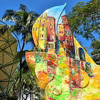 Colorful Sailboat Sculpture in Fort Lauderdale, Florida<br /> This colorful sailboat sculpture that features a scene from the Grand Canal in Venice is the work of artist Ilea Haber. It is one of several painted sailboats sponsored by Art in Public Places that you&rsquo;ll find along the Riverwalk in Fort Lauderdale.  On the left is the band shell at Huizenga Plaza.  It is the scene of frequent outdoor concerts.