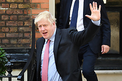 © Licensed to London News Pictures. 12/07/2019. London, UK. Conservative Party leadership candidate BORIS JOHNSON is seen leaving a property in Westminster, London. Later this month the Conservative Party will select a new leader and Prime Minister, following Theresa May's announcement that she will step down. Photo credit: Ben Cawthra/LNP