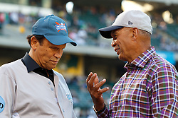 OAKLAND, CA - JUNE 14:  Philanthropist Michael Milken and Baseball Hall of Fame inductee Reggie Jackson stand on the field for the Prostate Cancer Foundation to raise awareness and funding for prostate cancer before the game between the Oakland Athletics and the New York Yankees at O.co Coliseum on June 14, 2014 in Oakland, California. The Oakland Athletics defeated the New York Yankees 5-1.  (Photo by Jason O. Watson/Getty Images) *** Local Caption *** Michael Milken; Reggie Jackson