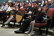 Goshen, New York - Children listen to a speaker at a Naturalization ceremony at the Orange County Emergency Services Center on Nov. 17, 2016. A total of 86 people from 45 countries took the Oath of Allegiance and became citizens of the United States of America.