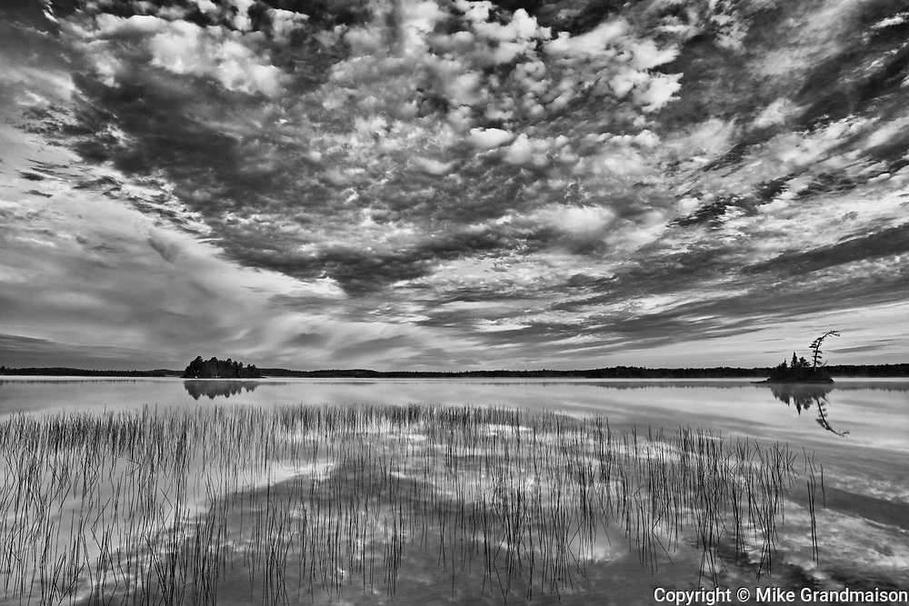Reflection on Lac des Sables at sunrise<br />Belleterre<br />Quebec<br />Canada