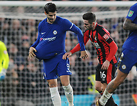 Football - 2017 / 2018 Carabao (EFL/League) Cup - Quarter-Final: Chelsea vs. AFC Bournemouth<br /> <br /> Alvaro Morata of Chelsea celebrates his 'Baby' pose with the ball up his shirt after scoring in injury time as Lewis Cook tries to get the ball back, at Stamford Bridge.<br /> <br /> COLORSPORT/ANDREW COWIE