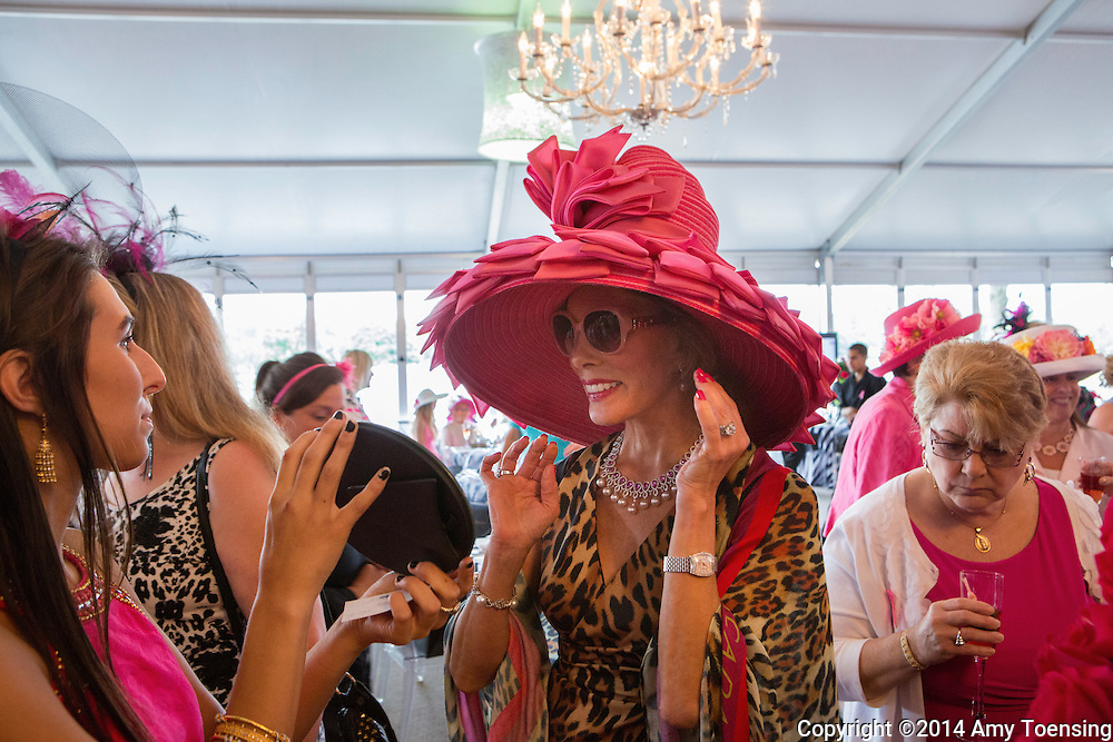 SARATOGA SPRINGS, NEW YORK - AUGUST 15, 2014: Michele Riggi (right) and her niece (left) attend the Sizzling Hot Pink Saratoga Hat Luncheon to benefit the Breast Cancer Research Foundation. Photo by Amy Toensing _________________________________<br />