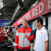 Arsenal Manager Arsène Wenger, (left), with Mike Petke, Head Coach of the New York Red Bulls during a photo opportunity and press conference at Red Bull Arena ahead of the friendly match between Arsenal and New York Red Bulls. Red Bull Arena, Harrison, New Jersey. USA. 24th July 2014. Photo Tim Clayton