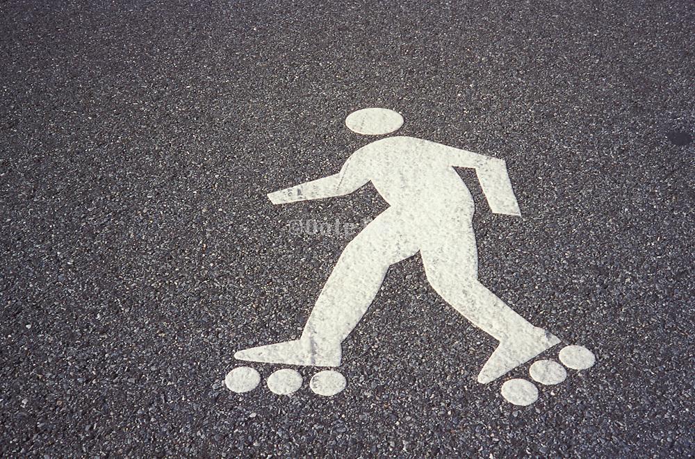 white painted figure of roller skater on asphalt