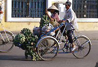Cyclo loaded with bananas in Hue, Vietnam
