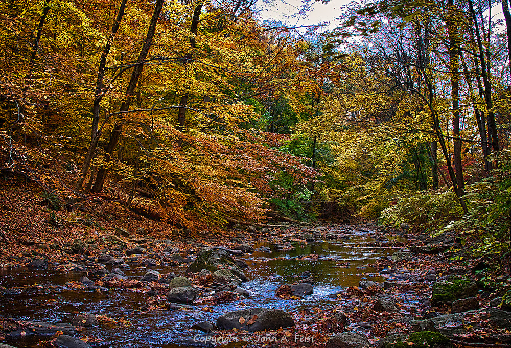 I was very fortunate to find a perfect day to be shooting at the old Sleepy Hollow cemetery (of Headless Horseman fame).  This stream flows through the cemetery and shows off some of the beautiful fall colors.