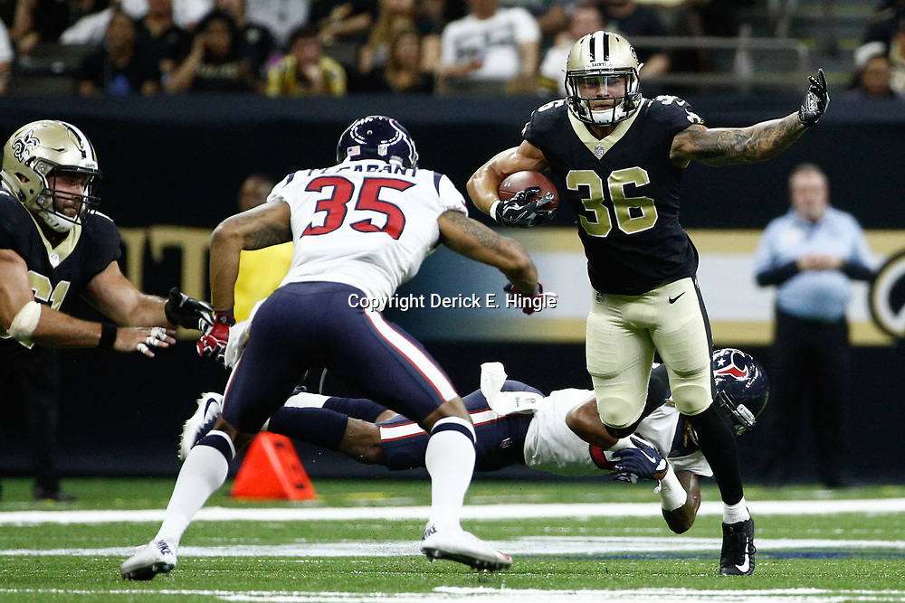 Aug 26, 2017; New Orleans, LA, USA; New Orleans Saints running back Daniel Lasco (36) escapes a tackle attempt by Houston Texans cornerback Treston Decoud (31) during the second quarter of a preseason game at the Mercedes-Benz Superdome. Mandatory Credit: Derick E. Hingle-USA TODAY Sports