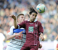 21.04.2012, Olympiastadion, Berlin, GER, 1. FBL, Hertha BSC Berlin vs 1. FC Kaiserslautern, 32. Spieltag, im Bild Christian LELL (Hertha BSC/links) und Olcay SAHAN (1. FC Kaiserslautern) im Kopfballduell. // during the German Bundesliga Match, 32th Round between Hertha BSC Berlin and 1. FC Kaiserslautern at the Olympiastadium, Berlin, Germany on 2012/04/21. EXPA Pictures © 2012, PhotoCredit: EXPA/ Eibner/ Johannes Koziol..***** ATTENTION - OUT OF GER *****