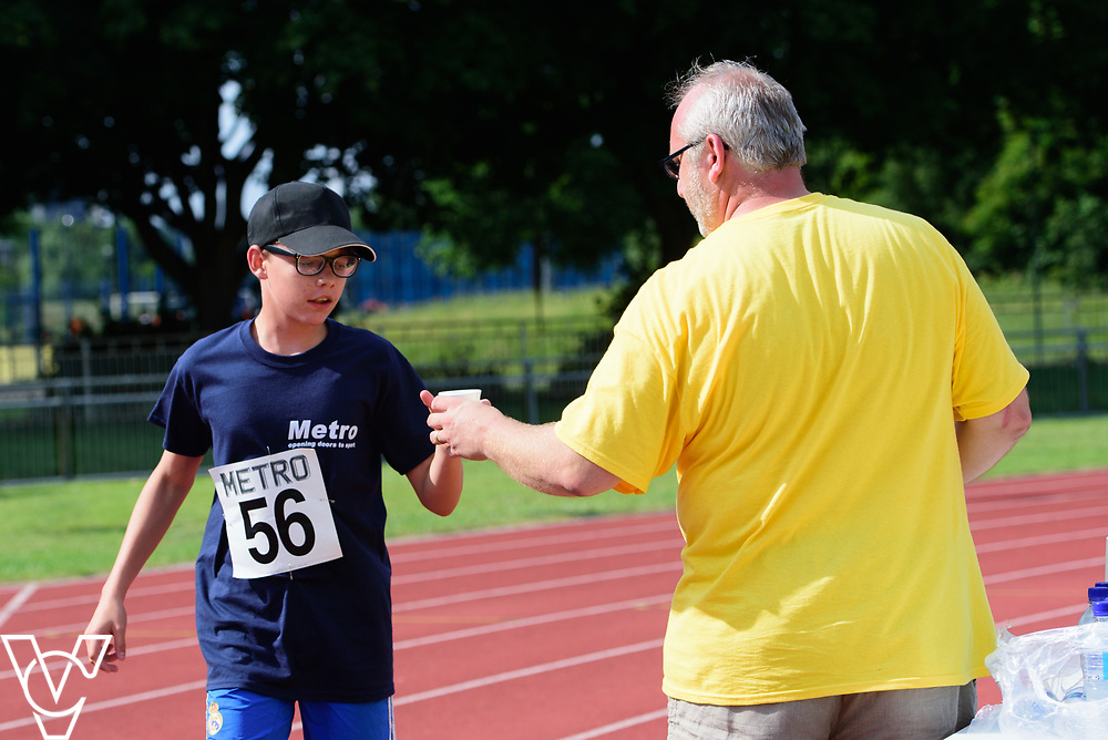 Metro Blind Sport's 2017 Athletics Open held at Mile End Stadium.  5000m.  Aaron Reynolds and volunteer<br /> <br /> Picture: Chris Vaughan Photography for Metro Blind Sport<br /> Date: June 17, 2017
