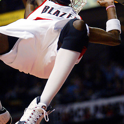 02/09/2005 - Portland Trailblazer, Darius Miles (23) gets his head caught in the net after a slam dunk against the New Orleans Hornets. The Blazers lost to the Hornets 80-91 at the Rose Garden.<br />