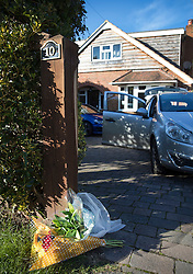 © Licensed to London News Pictures. 03/10/2016. Crowthorne, UK.  Flowers are left outside a house where police found a women in her 50's, who was dead, and an injured man. It is thought that the incident is being treated by the Thames Valley Police as one case of murder and one of attempted suicide.  Photo credit: Peter Macdiarmid/LNP