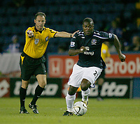 Photo: Steve Bond.<br />Sheffield Wednesday v Everton. Carling Cup. 26/09/2007.Referee Rob Styles waves play on  as Ayegbeni Yakubu attacks