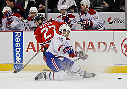 Jan 22, 2010; Newark, NJ, USA; Montreal Canadiens center Maxim Lapierre (40) steals the puck from New Jersey Devils defenseman Mike Mottau (27) during the second period at the Prudential Center.