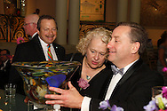 (from left at desk) Leib and Barbara Lurie Lurie of Troy and winner Rob Klaben look at a glass vase made by James Michael during the 56th Art Ball, 'Art is in the Air', at the Dayton Art Institute, Saturday, June 8, 2013.  Klaben was one of 100 raffle winners, which for the first time included an online ticket sale as well as to those at the 2013 Art Ball.
