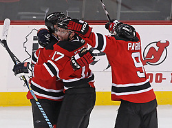 Feb 5, 2010; Newark, NJ, USA; New Jersey Devils left wing Ilya Kovalchuk (17), New Jersey Devils left wing Zach Parise (9), and New Jersey Devils center Travis Zajac (19) celebrate Zajac's tying goal during the third period at the Prudential Center. The Devils rallied with three goals in the period to win 4-3.