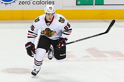 Feb 10, 2012; San Jose, CA, USA; Chicago Blackhawks center Andrew Shaw (65) warms up before the game against the San Jose Sharks at HP Pavilion. Mandatory Credit: Jason O. Watson-US PRESSWIRE