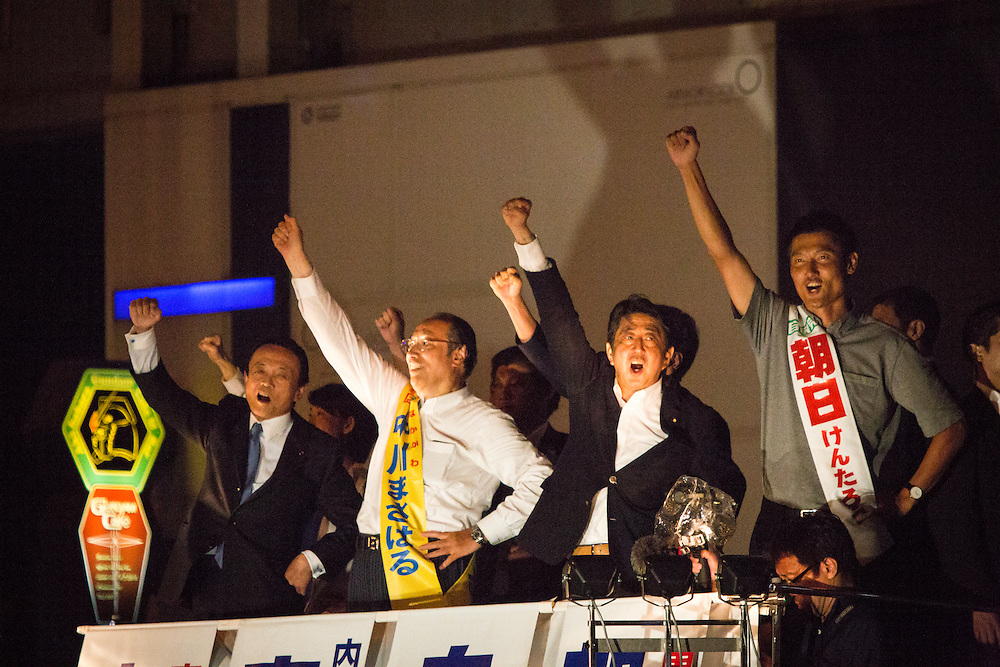 TOKYO, JAPAN - JULY 9 :  Japanese Prime Minister Shinzo Abe (center left) , president of the ruling Liberal Democratic Party (LDP), Tarō Asō (left), and candidates Masaharu Nakagawa (center left)  and candidate Kentaro Asahi (right) raises their fists to celebrate the last day of campaign during the Upper House election campaign outside of Akihabara Station in Tokyo, Japan on July 9, 2016. Tomorrow, July 10, 2016 will be the first Upper house election nation-wide in Japan that 18 years old can vote after government law changes its voting age from 20 years old to 18 years old. (Photo by Richard Atrero de Guzman/NURPhoto)