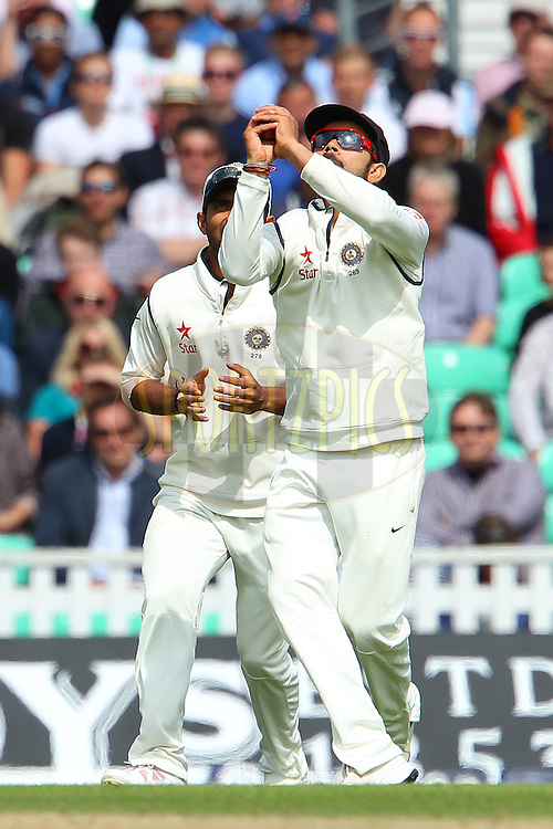 Virat Kohli of India takes the catch to dismiss Stuart Broad of England during day three of the fifth Investec Test Match between England and India held at The Kia Oval cricket ground in London, England on the 17th August 2014<br /> <br /> Photo by Ron Gaunt / SPORTZPICS/ BCCI