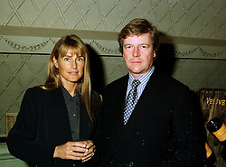 The HON.CHARLES & MRS PEARSON, he is the brother of Viscount Cowdray, at a reception in London on 22nd May 1997.LYL 4