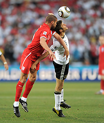 Matthew UPSON (li, England) and Thomas MUELLER  during the 2010 World Cup Soccer match between England and Germany in a group 16 match played at the Freestate Stadium in Bloemfontein South Africa on 27 June 2010.